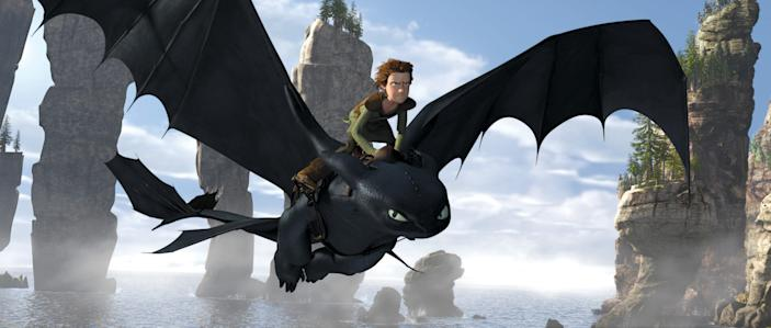 """Hiccup (voiced by Jay Baruchel) and buddy Toothless fly high in """"How to Train Your Dragon."""""""