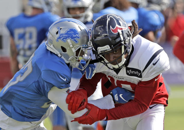 Houston Texans wide receiver DeAndre Hopkins (10) works against Detroit Lions cornerback Darius Slay (23) during an NFL football joint training camp practice Wednesday, Aug. 14, 2019, in Houston. (AP Photo/David J. Phillip)