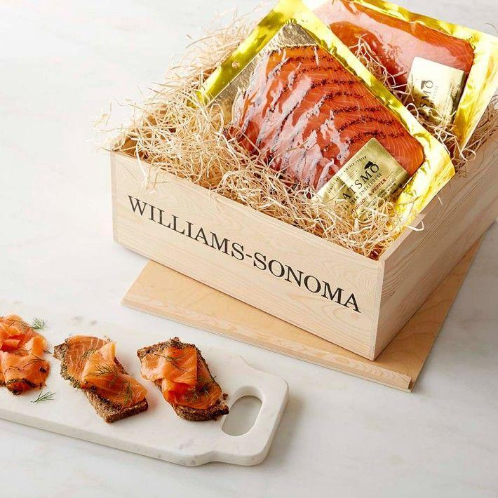 "<p>williams-sonoma.com</p><p><strong>$139.95</strong></p><p><a href=""https://go.redirectingat.com?id=74968X1596630&url=https%3A%2F%2Fwww.williams-sonoma.com%2Fproducts%2Fcatsmo-smoked-salmon-trio-gift-crate&sref=https%3A%2F%2Fwww.townandcountrymag.com%2Fleisure%2Fdining%2Fg23937264%2Fgourmet-food-gifts%2F"" rel=""nofollow noopener"" target=""_blank"" data-ylk=""slk:Shop Now"" class=""link rapid-noclick-resp"">Shop Now</a></p><p>Give your brunch loving buddy something worth getting up for with this collection of presliced bourbon & pepper, pastrami-style, and gravlax cured salmon. </p>"