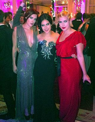 In a plunging silver gown, Rumer Willis steals the spotlight from younger sisters Tallulah, center, and Scout, right. Rumer tweeted the photograph of the three siblings posing at Le Bal des Debutantes in Paris, where Tallulah was making her high society debut Nov. 25. Father Bruce Willis attended but mother Demi Moore, laying low after announcing her divorce from Ashton Kutcher, was absent