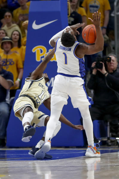 Georgia Tech's Bubba Parham (11) fouls Pittsburgh's Xavier Johnson (1) during the first half of an NCAA college basketball game, Saturday, Feb. 8, 2020, in Pittsburgh. (AP Photo/Keith Srakocic)