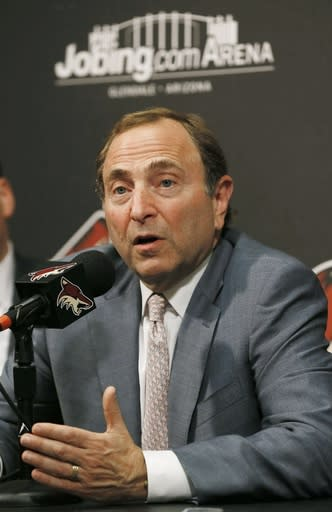 NHL Commissioner Gary Bettman speaks at a new conference before an NHL hockey game between the New York Rangers and the Phoenix Coyotes, Thursday, Oct. 3, 2013, in Glendale, Ariz. (AP Photo/Ross D. Franklin)
