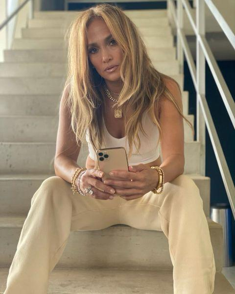 """<p>The 51 year-old glammed-up her sports bra and tracksuit bottoms with plenty of <a href=""""https://www.elle.com/uk/fashion/what-to-wear/g34359363/best-designer-jewellery/"""" rel=""""nofollow noopener"""" target=""""_blank"""" data-ylk=""""slk:stacked, chunky jewellery"""" class=""""link rapid-noclick-resp"""">stacked, chunky jewellery</a> while on set for her next film Shotgun Wedding'.</p><p><a class=""""link rapid-noclick-resp"""" href=""""https://www.elle.com/uk/fashion/what-to-wear/articles/g31236/best-loungewear-tops-trousers-robes-to-buy-now/"""" rel=""""nofollow noopener"""" target=""""_blank"""" data-ylk=""""slk:SHOP LOUNGEWEAR NOW"""">SHOP LOUNGEWEAR NOW</a></p><p><a href=""""https://www.instagram.com/p/CNfxeIXpVtf/"""" rel=""""nofollow noopener"""" target=""""_blank"""" data-ylk=""""slk:See the original post on Instagram"""" class=""""link rapid-noclick-resp"""">See the original post on Instagram</a></p>"""