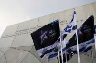 FILE PHOTO: Israeli flags and flags bearing the logo of the 2019 Eurovision song contest flutter outside the Tel Aviv Museum of Art, during the Eurovision Semi-Final allocation draw, in Tel Aviv