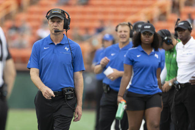 Air Force head coach Troy Calhoun walks down the sideline during the first half of an NCAA college football game against Hawaii, Saturday, Oct. 19, 2019, in Honolulu. (AP Photo/Eugene Tanner)