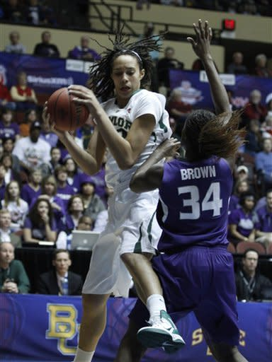Baylor center Brittney Griner (42) rebounds the ball over Kansas State forward Branshea Brown (34) in the first half of a semifinal game at the NCAA college women's Big 12 conference basketball tournament, Friday, March 9, 2012 in Kansas City, Mo. (AP Photo/Jeff Tuttle)