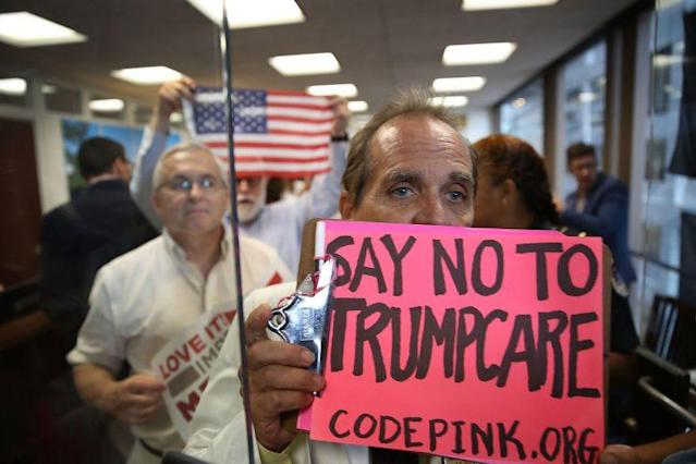 Protesters walk out of the office of Sen. Dean Heller on July 17. The protesters were asking the senator to vote no on the Better Care Reconciliation Act. (Photo: Joe Raedle/Getty Images)