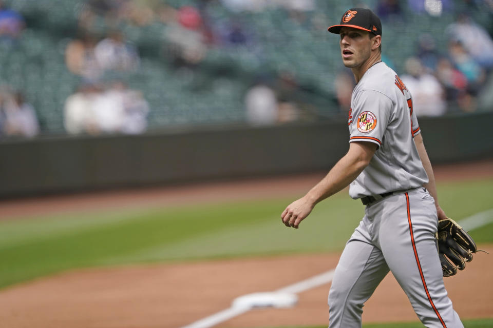 Baltimore Orioles starting pitcher John Means walks off the field after the sixth inning against the Seattle Mariners during a baseball game, Wednesday, May 5, 2021, in Seattle. (AP Photo/Ted S. Warren)