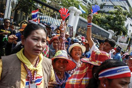 Farmers take part in a rally demanding the Yingluck administration resolve delays in payment, in Bangkok
