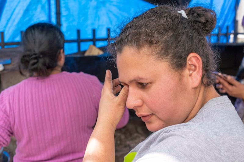 """Elvia Nunez, 36, fled Honduras with her two teenage daughters after a gunmen killed her husband in front of her family. After crossing the border illegally in south Texas in August, U.S. border officials flew her to San Diego, then sent her to Tijuana, Mexico, under the """"Remain in Mexico"""" policy."""