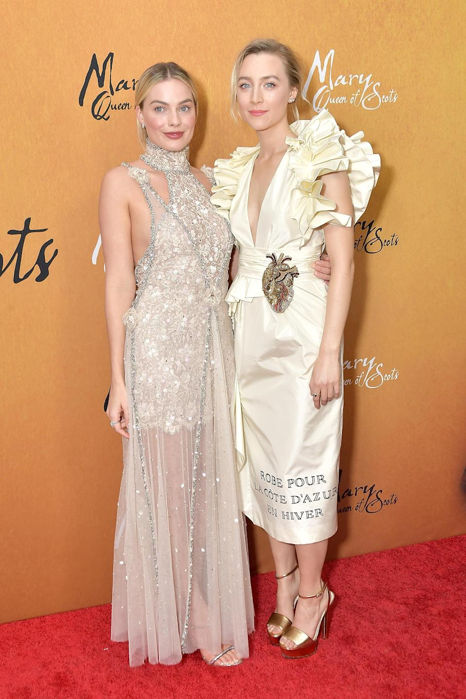 <p>Margot dazzled in a Chanel number while Saoirse looked regal in Gucci. <em>[Photo: Getty]</em> </p>