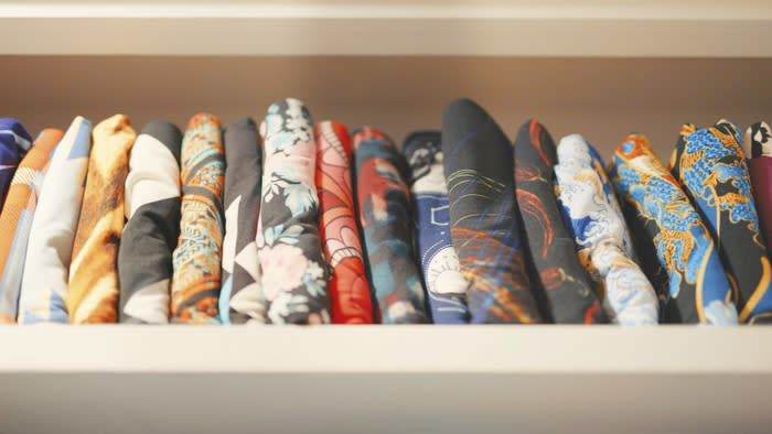 An image from Amazon Prime Video's documentary LuLaRich showing LuLaRoe branded leggings folded in a drawer