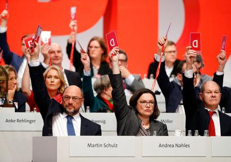 Social Democratic Party (SPD) delegates vote to enter talks with Chancellor Merkel's conservatives on negotiating a government, during an SPD party convention in Berlin