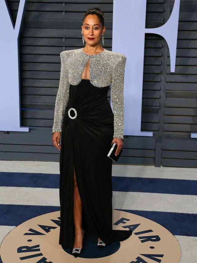 <p>The<em> Black-ish</em> star looked regal in her silver and black dress. (Photo: JEAN-BAPTISTE LACROIX/AFP/Getty Images) </p>
