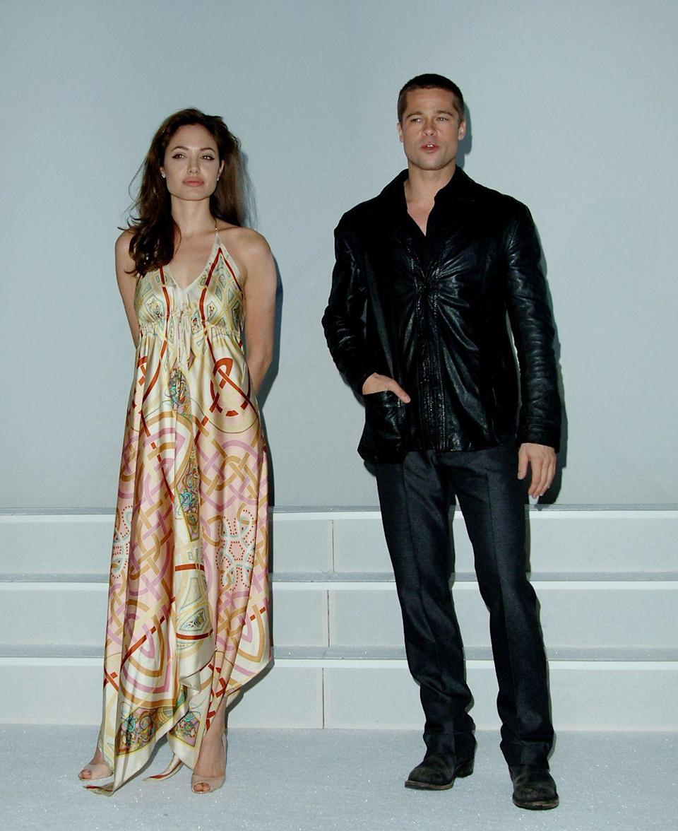 <p>Pitt and Jolie make their first joint appearance to promote <em>Mr. and Mrs. Smith</em> at ShoWest in March 2005. The duo kept one another at arm's length for photos.</p>
