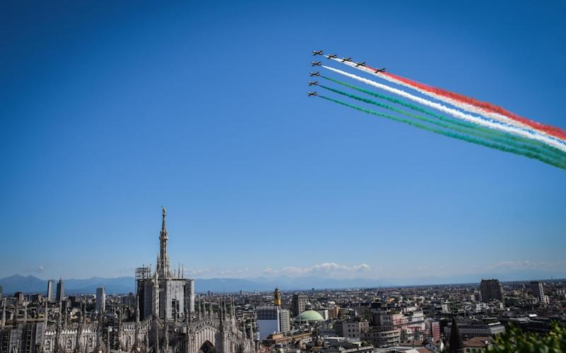 The aerobatic demonstration team of the Italian Air Force, flies in formation above Milan, 25 May 2020. Starting from 25 May, the Frecce Tricolori will perform every day throughout Italy as part of the 74th anniversary celebrations of the founding of the Italian Republic and to pay homage to the areas most affected by the coronavirus pandemic - Shutterstock