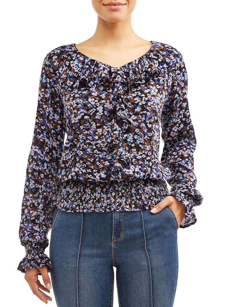 This breezy top is available in two colors and pairs well with any jean style. (Photo: Walmart)