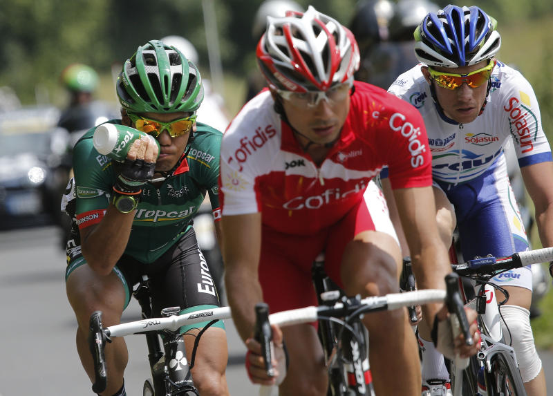 Yukiya Arashiro of Japan, Remy Di Gregorio of France, and Anthony Delaplace of France, from left, ride in the breakaway group during the fourth stage of the Tour de France cycling race over 214.5 kilometers (133.3 miles) with start in Abbeville and finish in Rouen, France, Wednesday July 4, 2012. (AP Photo/Christophe Ena)