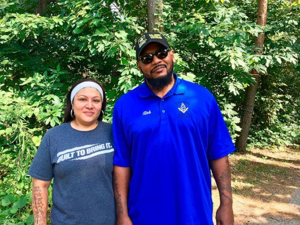 PHOTO: This undated photo shows Reyna and Rob Mathis, who found racist memorabilia in a home owned by a Muskegon police officer, pose for a portrait outside their home in Muskegon, Mich. (Justine Lofton/Muskegon Chronicle via AP)
