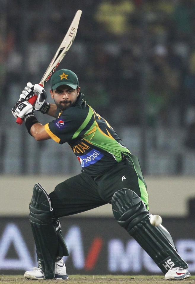 Pakistan's Ahmed Shehzad plays a ball against Bangladesh during their one-day international (ODI) cricket match in Asia Cup 2014 in Dhaka March 4, 2014. REUTERS/Andrew Biraj (BANGLADESH - Tags: SPORT CRICKET)