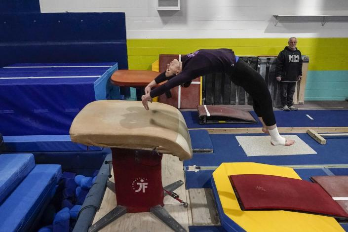 Former gymnastics world champion and Olympic silver medalist Chellsie Memmel works out with her father and coach Andy Memmel Thursday, Feb. 18, 2021, in New Berlin, Wisc. (AP Photo/Morry Gash)