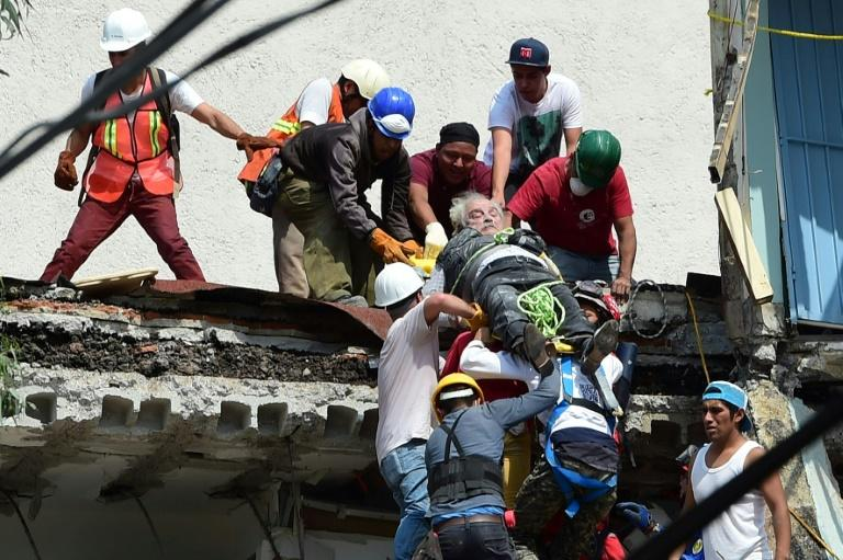 A man being pulled alive from the rubble following the powerful quake that struck Mexico City on Tuesday