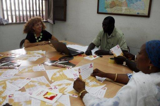 French-born Senegalese candidate Laurence Gavron (L), running for the TEKKI party in upcoming legislative elections speaks with fellow candidates El Hadji Sarr (C) and Aissatou Thiam at the party's headquarters in Dakar. Senegal voted for a new parliament with President Macky Sall seeking a majority to put his policies into action after ousting the veteran former leader Abdoulaye Wade in March