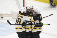 Boston Bruins center Patrice Bergeron (37) celebrates his goal with right wing David Pastrnak (88) and left wing Brad Marchand (63) during the third period in Game 5 of an NHL hockey Stanley Cup first-round playoff series against the Washington Capitals, Sunday, May 23, 2021, in Washington. The Bruins won 3-1. (AP Photo/Nick Wass)