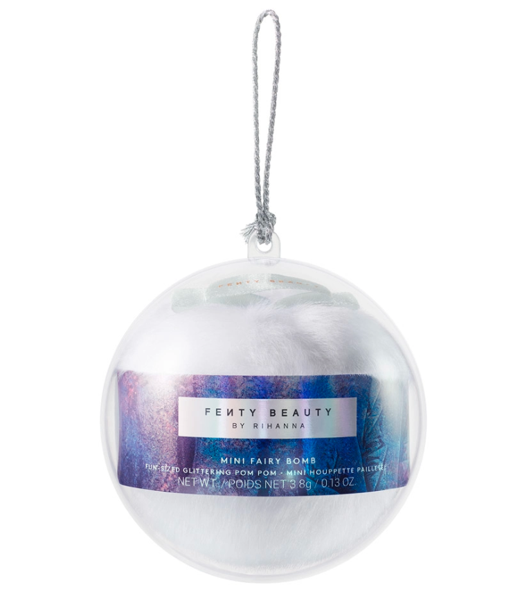 Pictured is a silver and blue Fenty Beauty Mini Fairy Bomb Glittering Pom Pom