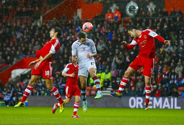 Southampton's Jack Cork, left, and Maya Yoshida, right, are unable to stop Burnley's Danny Ings, center, getting a header on target during their FA Cup third round soccer match at St Mary's, Southampton, England, Saturday, Jan. 4, 2014. (AP Photo/Chris Ison, PA Wire)