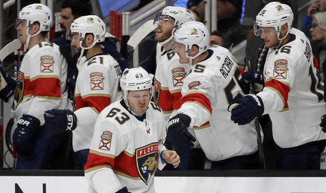 Florida Panthers' Evgenii Dadonov (63) is congratulated by teammates after scoring a goal against the San Jose Sharks in the first period of an NHL hockey game Monday, Feb. 17, 2020, in San Jose, Calif. (AP Photo/Ben Margot)