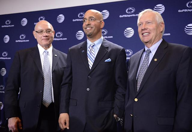 Penn State's new football coach James Franklin, center, poses with athletic director David Joyner, left. and Penn State president Rodney Erickson, right, after being introduced during an NCAA college football news conference on Saturday, Jan. 11, 2014, in State College, Pa. (AP Photo/John Beale)