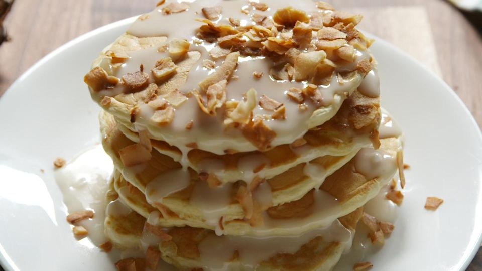 """<p>Your favorite cocktail...for breakfast!</p><p>Get the recipe from <a href=""""/cooking/recipe-ideas/recipes/a47167/pina-colada-pancake-recipe/"""" data-ylk=""""slk:Delish"""" class=""""link rapid-noclick-resp"""">Delish</a>.</p>"""
