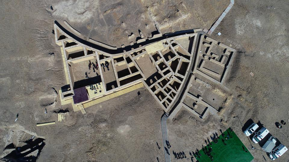 An aerial photo shows participants into an interreligious meeting with Pope Francis' visit what is believed to be Abraham's house in the archaeological area of the Sumerian city-state of Ur, 20 kilometers southwest of Nasiriyah, Iraq, Saturday, March 6, 2021. Pope Francis arrived in Iraq on Friday to urge the country's dwindling number of Christians to stay put and help rebuild the country after years of war and persecution, brushing aside the coronavirus pandemic and security concerns to make his first-ever papal visit. (AP Photo/Nabil al-Jourani)