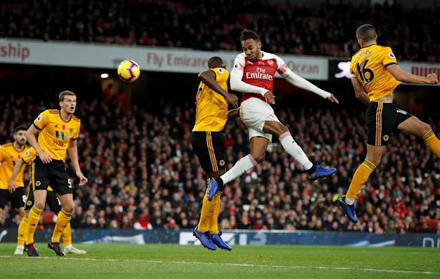 """Soccer Football - Premier League - Arsenal v Wolverhampton Wanderers - Emirates Stadium, London, Britain - November 11, 2018 Arsenal's Pierre-Emerick Aubameyang heads at goal before their first goal Action Images via Reuters/John Sibley EDITORIAL USE ONLY. No use with unauthorized audio, video, data, fixture lists, club/league logos or """"live"""" services. Online in-match use limited to 75 images, no video emulation. No use in betting, games or single club/league/player publications. Please contact your account representative for further details."""