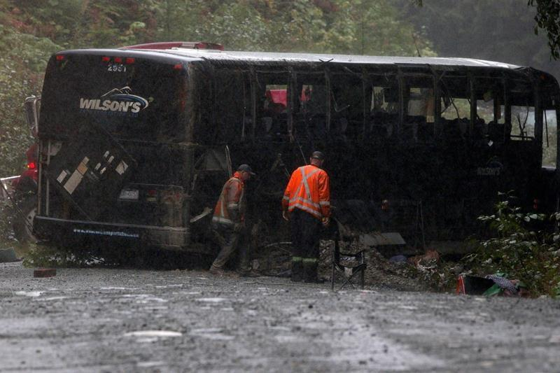 University says it's making changes after bus crash that killed two students