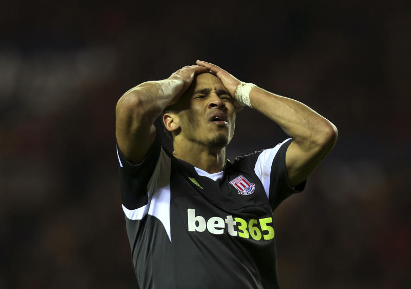 Stoke City's Peter Odemwingie reacts after failing to score a goal during their English Premier League soccer match against Sunderland at the Stadium of Light, Sunderland, England, Wednesday, Jan. 29, 2014. (AP Photo/Scott Heppell)
