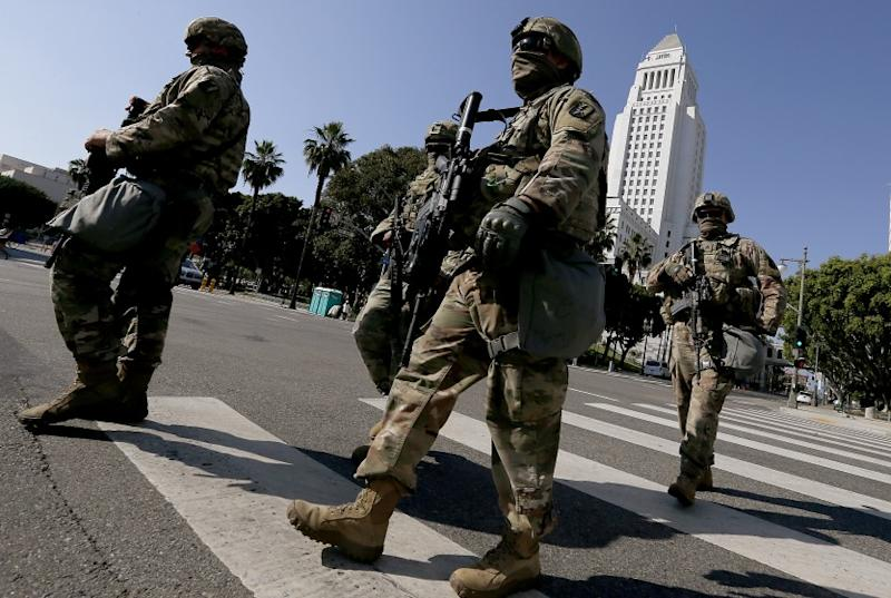 LOS ANGELES, CALIF. - JUNE 4, 2020. National Guardsmen cross the intersection of First and Main streets in downtown Los Angeles on Thursday, June 4, 2020, ahead of a large demonstration to demand justice for George Floyd, a black man killed by a white police officer in Minneapolis more than one week ago. Curfews have been lifted throughout L.A. County as mostly peaceful protests continue. (Luis Sinco/Los Angeles Times)