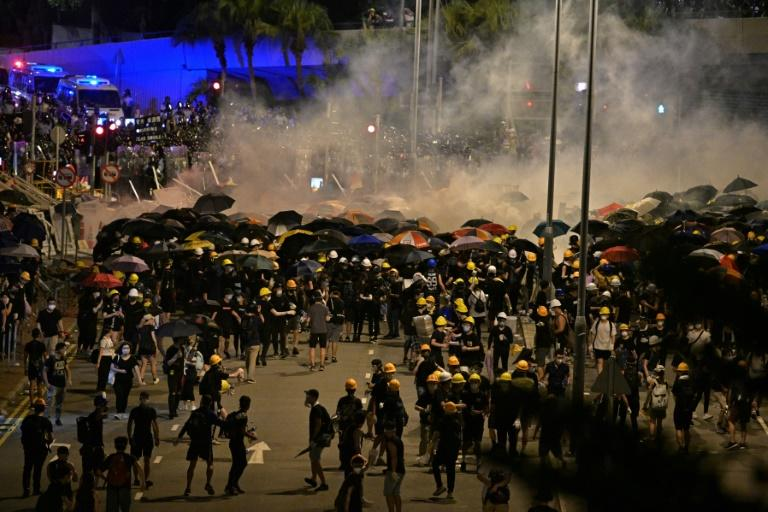 Just after midnight officers moved in, scattering protesters with tear gas and baton-charges, sending plumes of smoke drifting across the heart of the financial hub