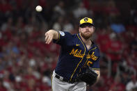 Milwaukee Brewers starting pitcher Brandon Woodruff throws to first during the first inning of a baseball game against the St. Louis Cardinals Tuesday, Sept. 28, 2021, in St. Louis. (AP Photo/Jeff Roberson)