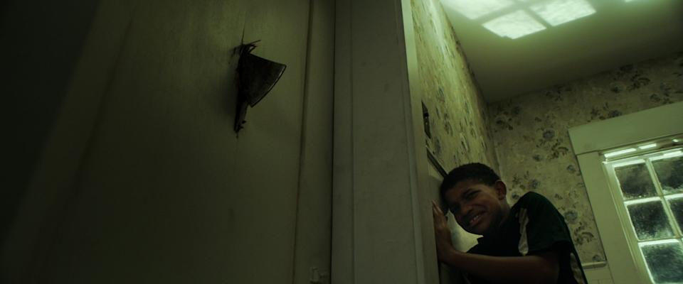 """Lonnie Chavis tries to stay alive and save his friend in the thriller """"The Boy Behind the Door."""""""