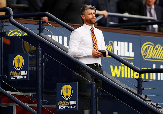 Soccer Football - Scottish Cup Final - Celtic vs Motherwell - Hampden Park, Glasgow, Britain - May 19, 2018 Motherwell manager Stephen Robinson looks dejected after collecting his runners up medal Action Images via Reuters/Jason Cairnduff