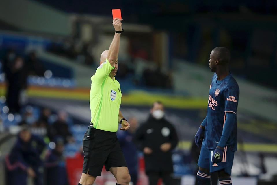 Nicolas Pepe (right) is shown a red card by referee Anthony Taylor during Arsenal's Premier League with Leeds United