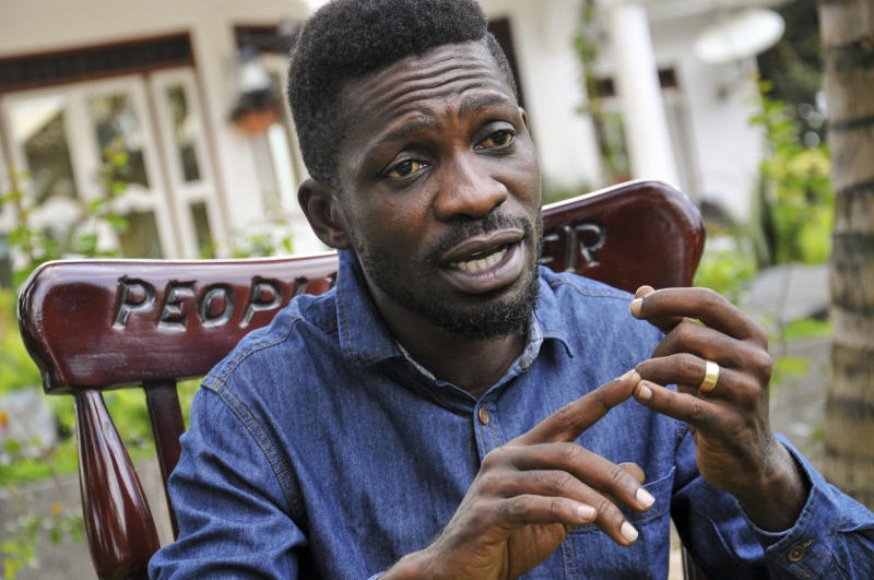 "In this photo taken Friday, March 27, 2020, Ugandan musician, lawmaker and presidential aspirant Bobi Wine, whose real name is Kyagulanyi Ssentamu, speaks to The Associated Press in Kampala, Uganda. Wine, who released a song in March 2020 urging Africa's people to wash their hands to stop the spread of the new coronavirus, is criticizing African governments for not maintaining better health care systems for the continent's 1.3 billion people while investing in weapons and ""curtailing the voices of the people"". (AP Photo/Ronald Kabuubi)"