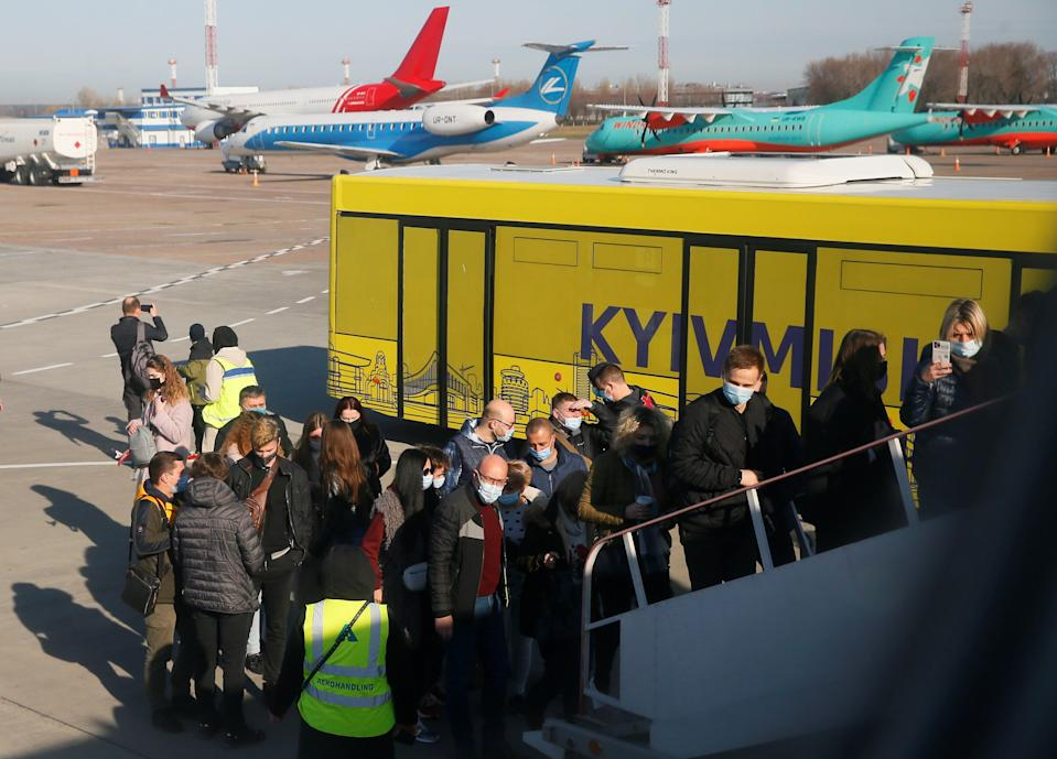 Passengers board aplaneduring a tour to the Chernobyl exclusion zone at the Boryspil International Airport outside Kyiv, Ukraine April 3, 2021. Ukraine International Airlines made a special offer marking the 35th anniversary of the Chernobyl nuclear disaster. Tourists get a bird's eye view of abandoned buildings in the ghost town of Pripyat and the massive domed structure covering a reactor of the Chernobyl Nuclear Power Plant that exploded on April 26, 1986. Picture taken April 3, 2021.