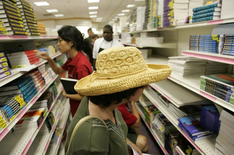 Sharlene Blau (foreground) shops for textbooks for her son Yoni, 21 who is out of town at the USC student store on 08/17/2005. As students go back to school, the cost of college text books is rising twice as fast as inflation, largely as the result of add–ons like CDs and workbooks according to a General Accounting Office report released last week. (Photo by Bob Chamberlin/Los Angeles Times via Getty Images)
