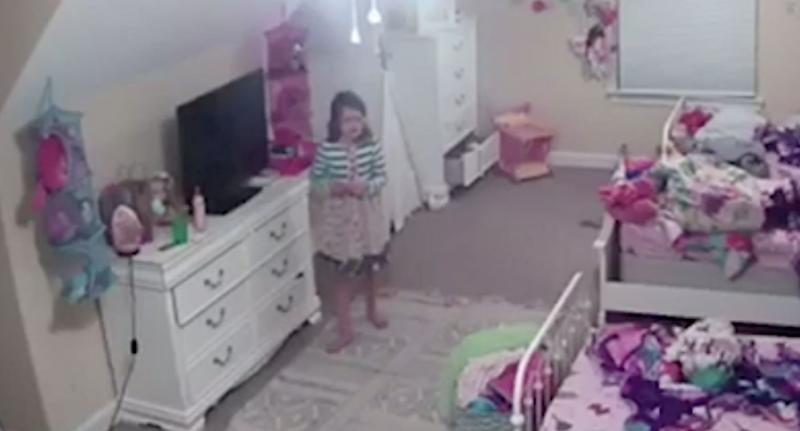 Girl, 8, in her bedroom while listening to voice of hacker through a security camera.