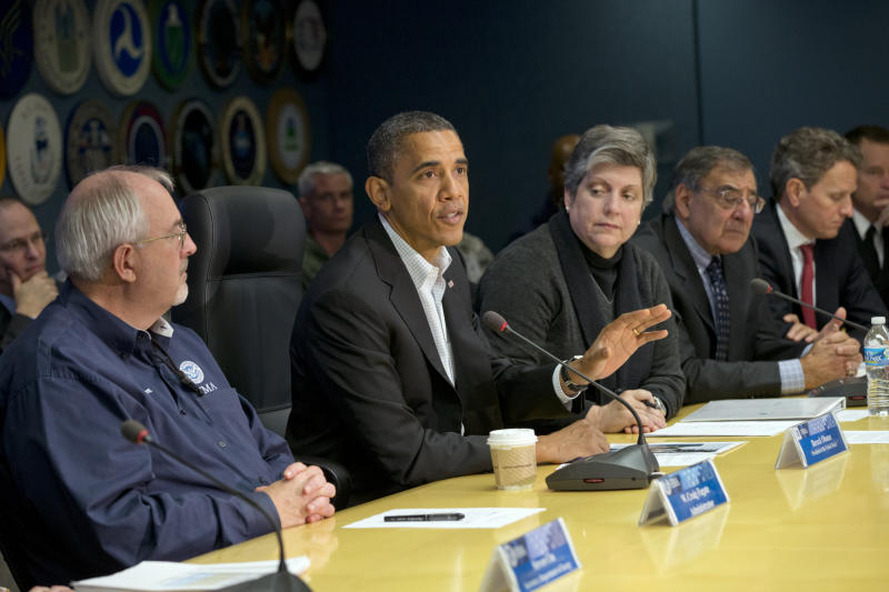 President Barack Obama visits the Federal Emergency Management Agency (FEMA) for an update on the recovery from Hurricane Sandy that hit New York and New Jersey especially hard earlier this week, Saturday morning, Nov. 3, 2012, in Washington. He is flanked by FEMA chief Craig Fugate, left, and Homeland Security Secretary Janet Napolitano, right.   Next to Napolitano is Defense Secretary Leon Panetta and Treasury Secretary Timothy Geithner, far right.  (AP Photo/J. Scott Applewhite)