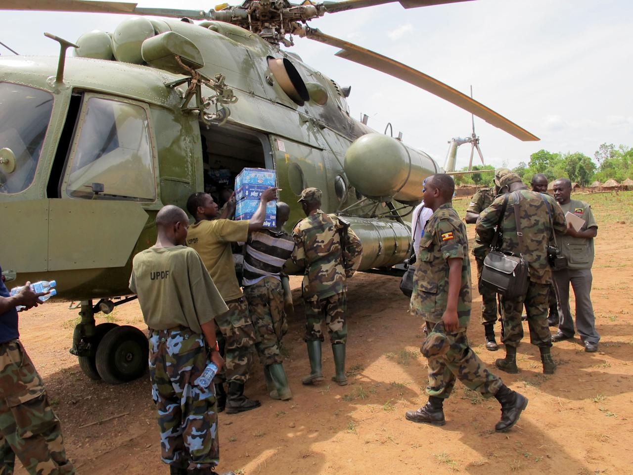 In this photo of Wednesday April 18, 2012 Ugandan troops load supplies to be sent to squadshunting for rebel leader Joseph Kony deep in the Central African Republic jungle. For Ugandan soldiers tasked with catching Joseph Kony, the real threat is not the elusive Central Africa warlord and his brutal gang. Encounters between Ugandan troops and Lords Resistance Army rebels are so rare that the Kony hunters worry about other things when they walk the jungle: armed poachers, wild beasts, honey bees, and even a widely-ranging fly that torments their ears during day. (AP Photo/Rodney Muhumuza)