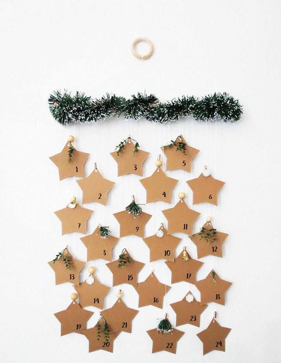 """<p>These paper stars may look thin, but they're actually ennvlopes with a slot big enough to put a small treat inside. You can hang them from a dowel with embroidery thread. </p><p><em><a href=""""https://www.ohohdeco.com/diy-paper-star-advent-calendar/"""" rel=""""nofollow noopener"""" target=""""_blank"""" data-ylk=""""slk:Get the tutorial at Oh Oh Deco »"""" class=""""link rapid-noclick-resp"""">Get the tutorial at Oh Oh Deco »</a></em></p>"""